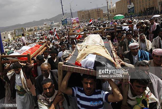 Yemeni antiregime mourners carry the coffins of fighters loyal to opposition tribal chief Sheikh Sadiq alAhmar during a mass funeral in Sanaa after...