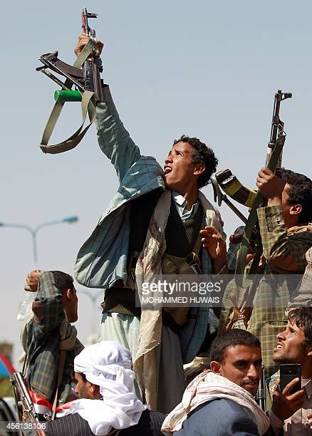 Yemeni armed supporters of the Shiite Huthi antigovernment movement take part in a rally to celebrate after they seized key state installations...