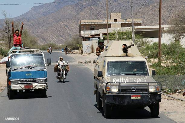 A Yemeni army military vehicle drives in a road near the southern town of Loder in Abiyan province where they fight against AlQaeda militants on...