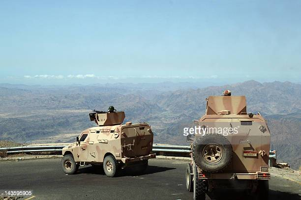 Yemeni army military vehicles drive in a road near the southern town of Loder in Abiyan province where they fight against AlQaeda militants on April...