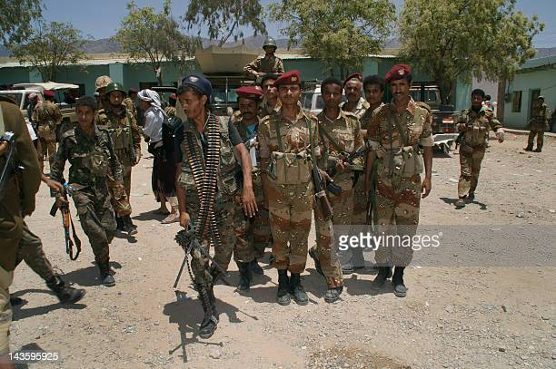Yemeni army soldiers gather at their military base in the southern town of Loder in Abiyan province where they fight against AlQaeda militants on...