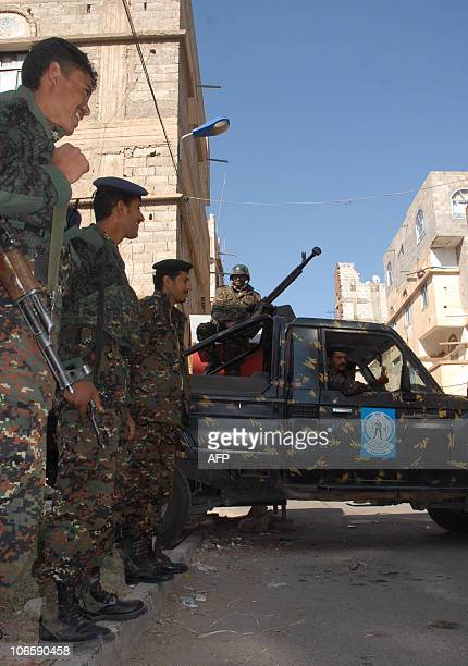 Yemeni army troops stand guard outside a court in Sanaa on November 6 2010 during a new hearing in the trial of radical USYemeni cleric Anwar...
