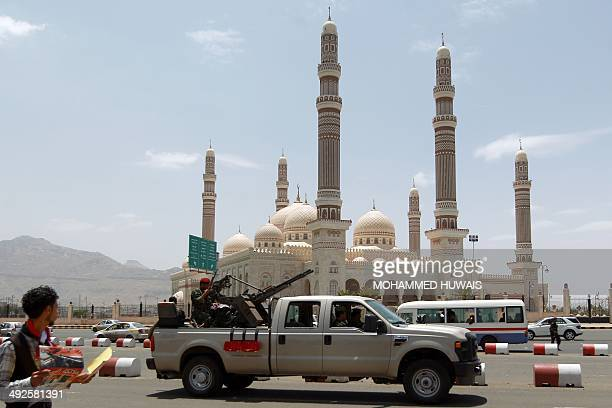 A Yemeni Army vehicle patrols past the alSaleh mosque in the capital Sanaa on May 21 2014 during a rally marking the twoyear anniversary of a suicide...