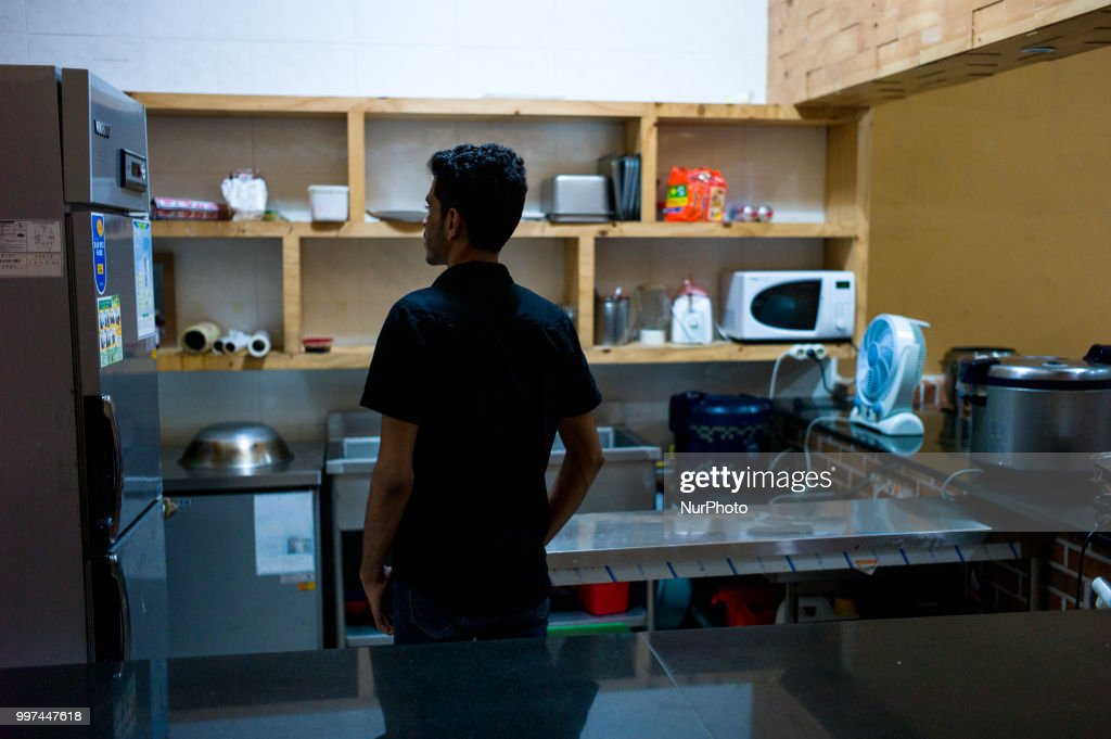 Yemeni asylum seeker Muhammad (25) pictured in a kitchen at the Olle Hotel in Jeju Isand, South Korea on June 28, 2018. Yemeni refugee applicants have been flying to Malaysia, where foreigners can stay for up to 90 days without a visa, before moving on to Jeju, which had a visa waiver program to encourage tourism. Some 549 people have submitted applications and 486 are staying on the island, waiting for the governments decision which could take up to 3 months.