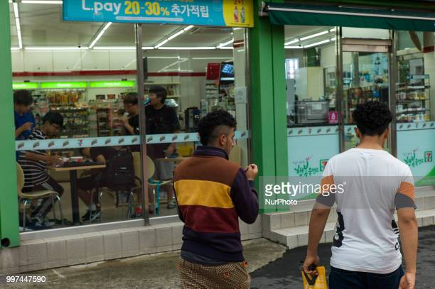 Yemeni asylum seekers walk around Jeju city in Jeju Island South Korea on June 27 2018 More than 550 Yemeni asylum seekers have sparked a backlash...