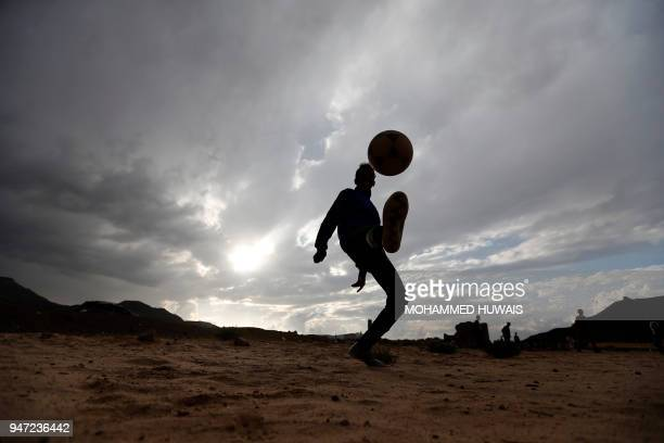 A Yemeni boy kicks up a football in the air during a match among friends and neighbours in the capital Sanaa on April 11 2018 A shock winning streak...