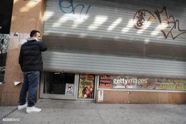 Yemeni business owner Musa closes the gate to his store February 2 2017 in the Brooklyn borough of New York City Across the city Yemeni owned bodega...