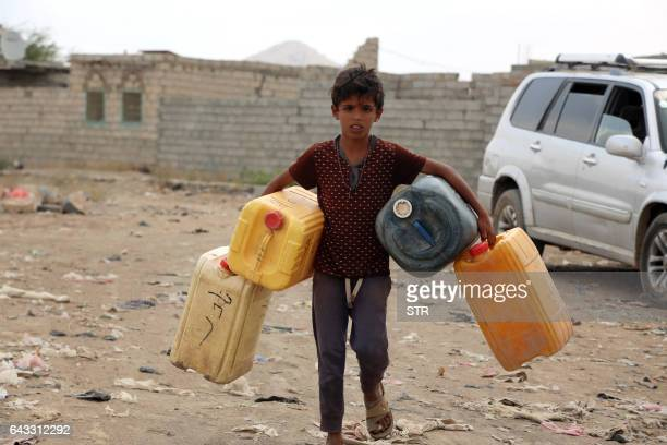 Yemeni child carries empty jerrycans amid continuing wide spread disruption of water supply in the impoverished coastal village on the outskirts of...