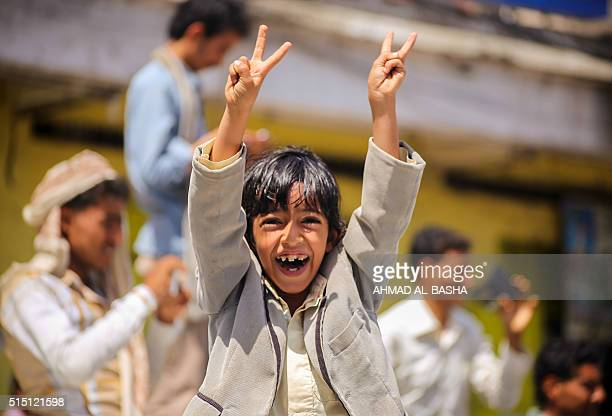 A Yemeni child celebrates after tribesmen from the Popular Resistance Committees supporting forces loyal to Yemen's Saudibacked president reportedly...