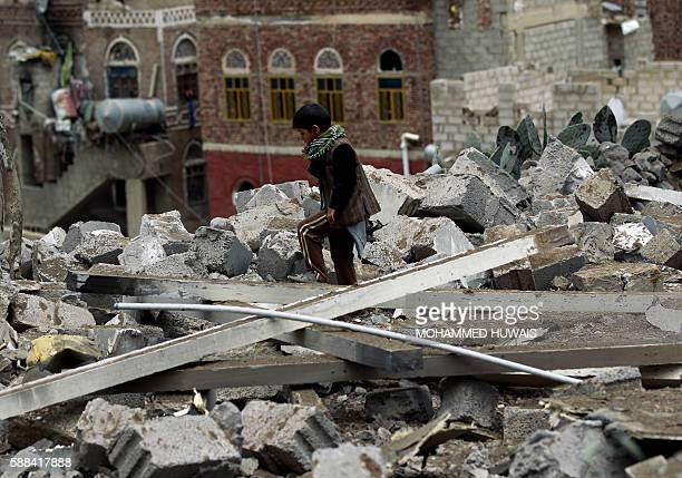 A Yemeni child inspects the rubble of a house in Yemen's rebelheld capital Sanaa on August 11 after it was reportedly hit by a Saudiled coalition air...
