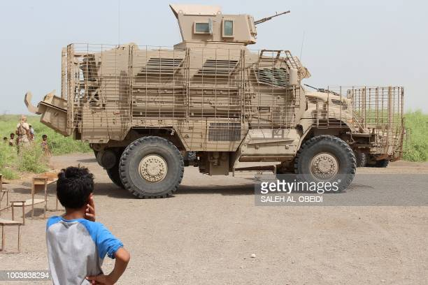 A Yemeni child looks at an armored vehicle as members of the Emirati armed forces take part in a campaign to raise awareness against mines and IED...