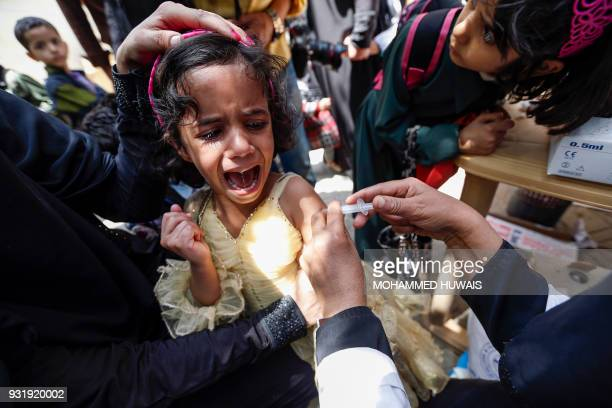 A Yemeni child receives a diphtheria vaccine at a health centre in the capital Sanaa on March 14 2018 More than eight million Yemenis are at risk of...