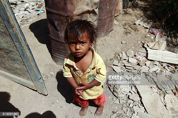 A Yemeni child stands outside the family house which was destroyed several months ago in an airstrike by the Saudiled coalition at a slum in the...