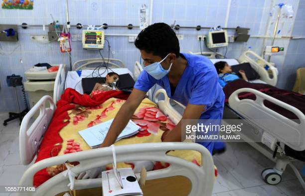 A Yemeni child suffering from a diphtheria infection receives treatment at a hospital in the capital Sanaa on October 31 2018 Yemen's brutal conflict...