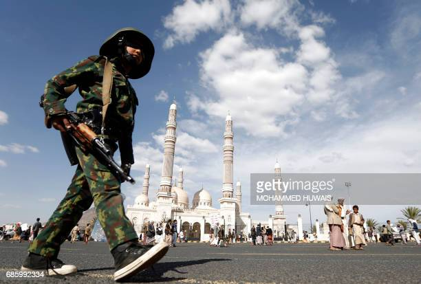A Yemeni child wearing military fatigues takes part in an antiUS protest staged by supporters of the Huthi rebels in Sanaa on May 20 2017 US...