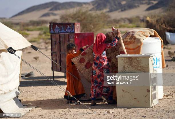 Yemeni children are pictured at the Jaw al-Naseem camp for internally displaced people on the outskirts of the northern city of Marib, on February...