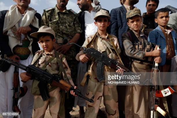 TOPSHOT Yemeni children carrying weapons take part in a gathering organised by Shiite Huthi rebels to mobilise more fighters to battlefronts to fight...