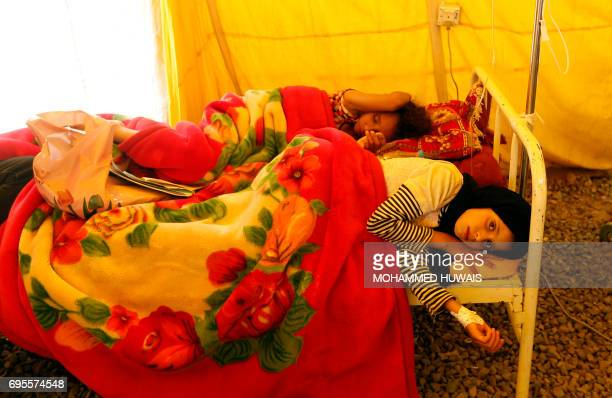 TOPSHOT Yemeni children infected with cholera receive treatment at Sabaeen Hospital in Sanaa on June 13 2017 Six weeks into the second outbreak of...