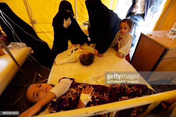 Yemeni children suspected of being infected with cholera receive treatment at Sabaeen Hospital in Sanaa on June 13 2017 Six weeks into the second...