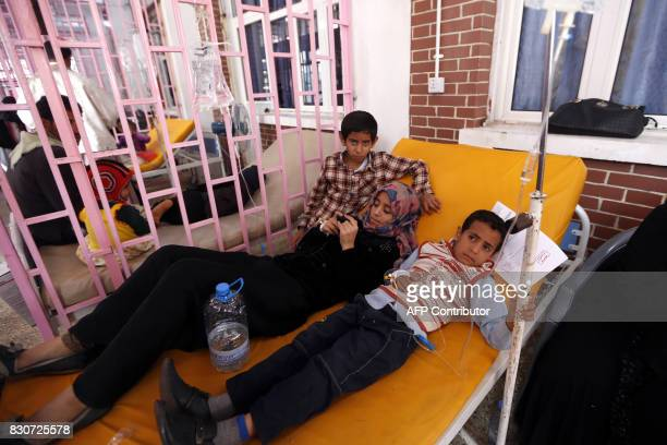 Yemeni children suspected of being infected with cholera receive treatment at a hospital in the capital Sanaa on August 12 2017 A cholera outbreak...