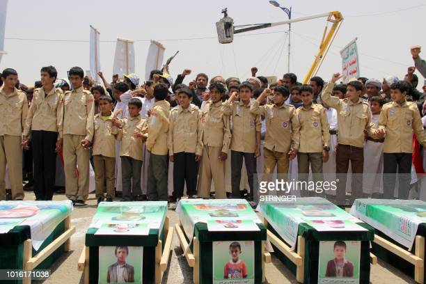 TOPSHOT Yemeni children vent anger against Riyadh and Washington on August 13 2018 as they take part in a mass funeral in the northern Yemeni city of...