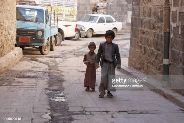 Yemeni children walk at a market on February 25, 2020 in Sana'a, Yemen. The United States Agency for International Development has stated that it...