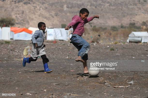 Yemeni children who fled their homes due to the ongoing war play near their makeshift shelter at an internally displaced camp on April 07 2018...