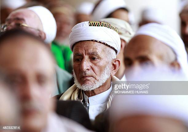 Yemeni clerics from the Zaidi sect an offshoot of Shiite Islam attend a meeting at the Great Mosque in the old city of Sanaa condemning attacks on...