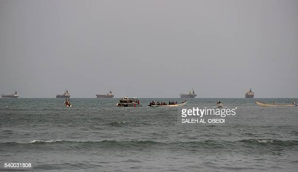Yemeni coast guards search in the waters off the southern coastal city of Aden for the remains of a United Arab Emirates helicopter from the Saudiled...