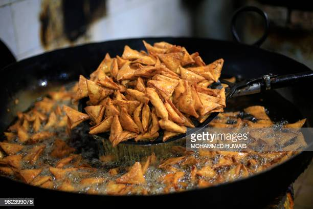 A Yemeni cook fried sambusa or samosa during the Muslim holy fasting month of Ramadan in the capital Sanaa on May 25 2018