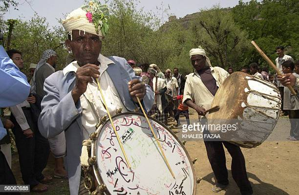 Yemeni countryside musicians celebrate Eid al-Fitr in the village of Bani Hammad in Yemen's Taiz province, 03 November 2005. Muslims around the world...