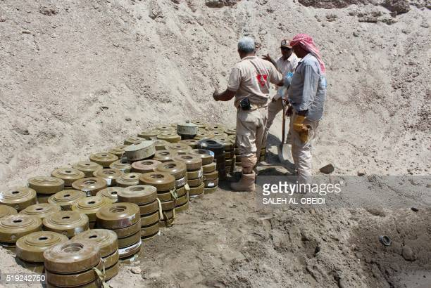 Yemeni demining experts prepare for a controlled explosion to destroy explosives and mines laid by Huthi rebels on April 5 2016 in the southern city...