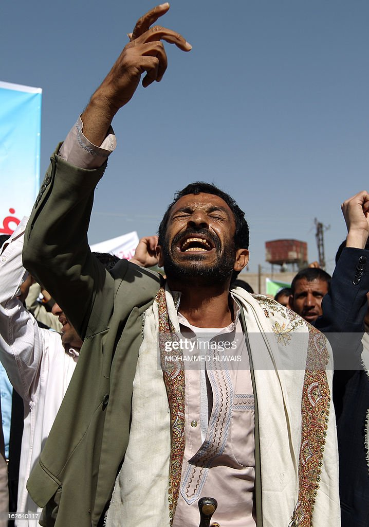A Yemeni demonstrator shouts slogans to demand the release of a Yemeni medical student, who was arrested in Syria last year, during a protest outside the Syrian embassy in Sanaa on February 25, 2013. According to local media sources the student was sentenced to death on February 24.