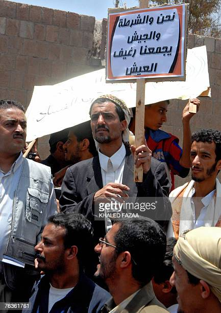 Yemeni demonstrators hold a placard reading in Arabic We the police and the army have bread in common during a rally in Sanaa 28 August 2007 Yemenis...