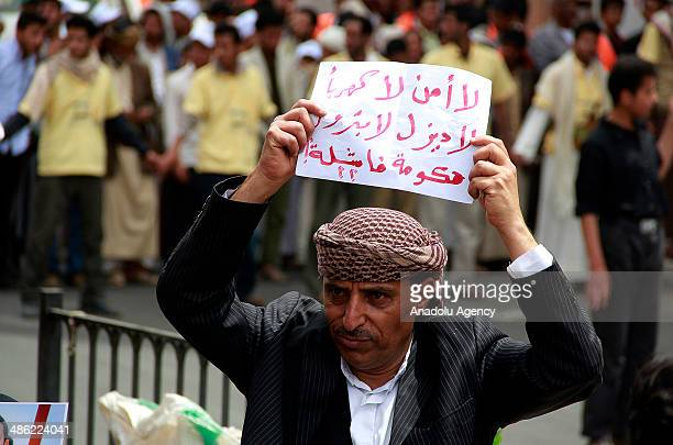 Yemeni demonstrators march from Sana'a University to the Ministry of Oil and Minerals during a protest against power cuts and fuel shortages in the...