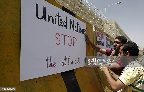 Yemeni demonstrators place placards on the concrete barriers of the Saudi embassy in Sanaa on April 11 2015 during a gathering denouncing the...
