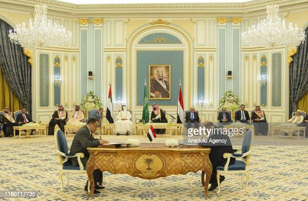 Yemeni Deputy Prime Minister Ahmed Saeed al-Khanbashi and Southern Transitional Council representative Nasser al-Habci are seen during a signing...