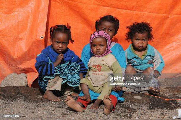Yemeni displaced children who with their families fled homes due to the ongoing war sit outside their makeshift shelter at an internally displaced...