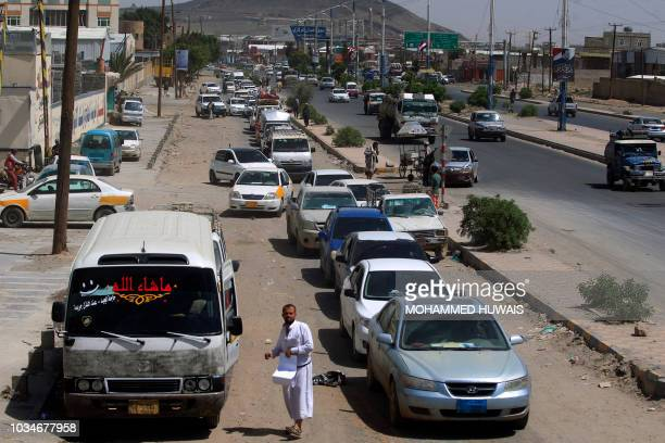 Yemeni drivers wait in line to buy fuel at a petrol station amid fuel shortages in the capital Sanaa on September 17 2018 Saudi Arabia and its allies...