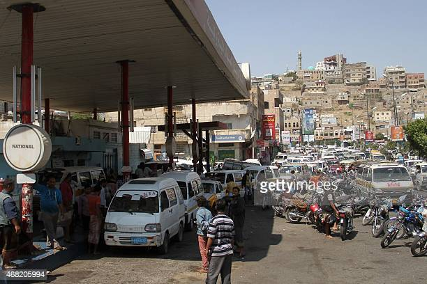 Yemeni drivers wait in line to refuel their vehicles at a gas station in the southwestern city of Taez on March 31, 2015. Iran warned that the Saudi...