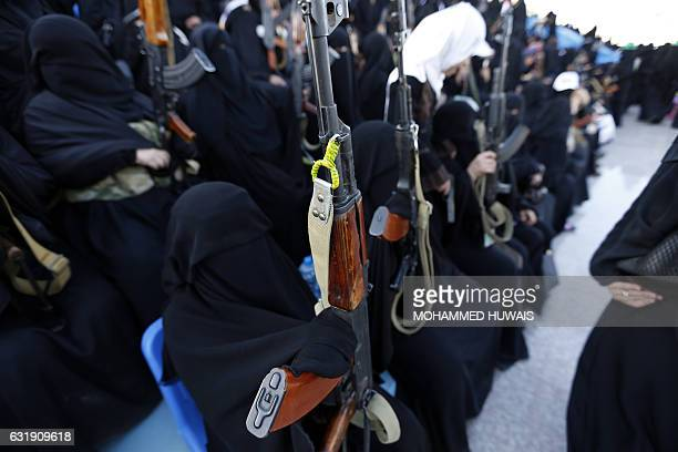 Yemeni female fighters supporting the Shiite Huthi rebels and carrying weapons used for ceremonial purposes take part in an antiSaudi rally in the...