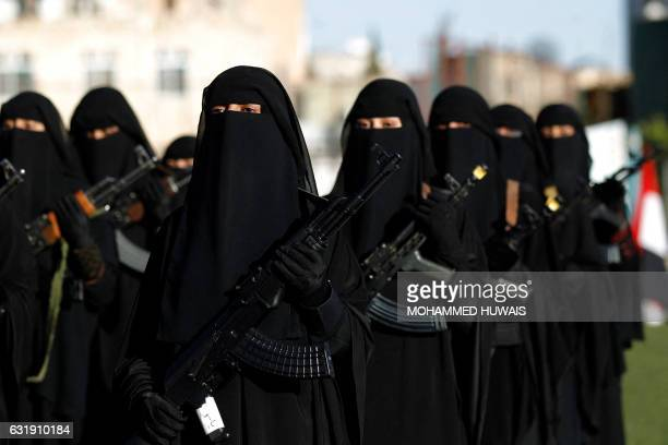 TOPSHOT Yemeni female fighters supporting the Shiite Huthi rebels and carrying weapons used for ceremonial purposes take part in an antiSaudi rally...