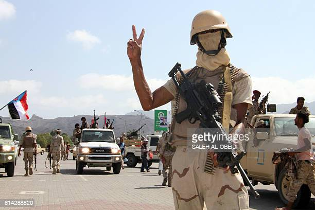 A Yemeni fighter from the separatist Southern Movement loyal to the government forces gestures as he stands guard during a rally marking the...