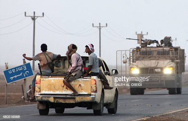 Yemeni fighters from the Popular Resistance Committees drive in armed vehicles in Emran west of the southern embattled Yemeni city of Aden after they...
