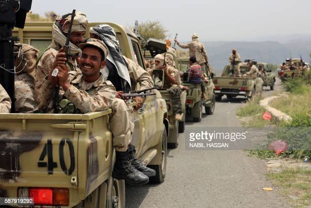 Yemeni fighters loyal to President Abedrabbo Mansour Hadi drive in convoy in the Yafa area some 180 kilometres north of the port city of Aden on...