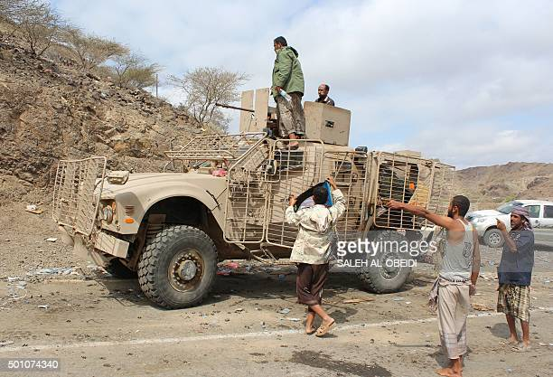 Yemeni fighters loyal to President Abedrabbo Mansour Hadi gather on the outskirts of the country's third city Taez, on December 12, 2015. The United...