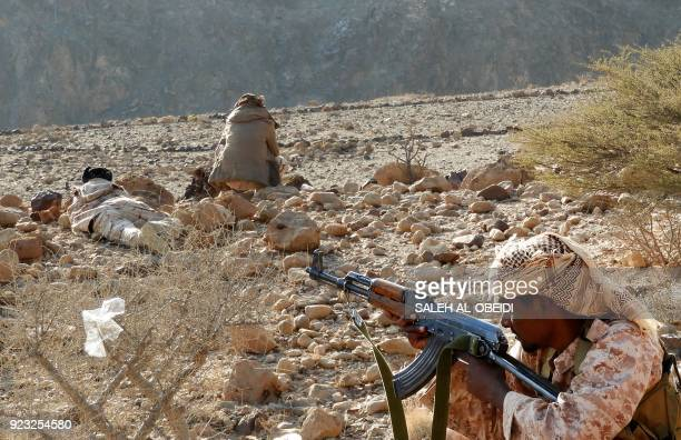 Yemeni fighters loyal to the government backed by the Saudiled coalition fighting in the country take position as they close in on a suspected...