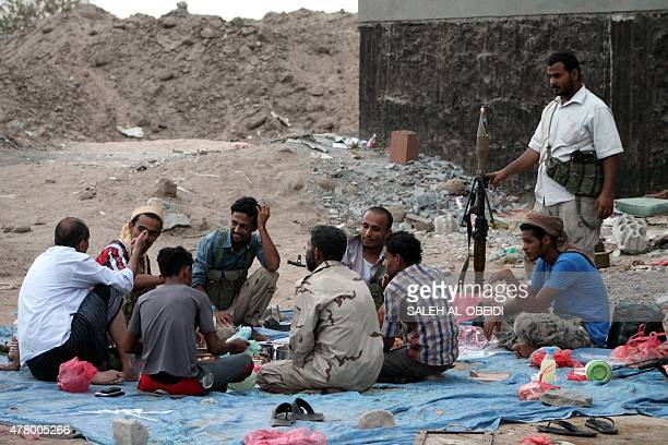 Yemeni fighters of the southern separatist movement loyal to exiled President Abedrabbo Mansour Hadi break their fast during the holy month of...