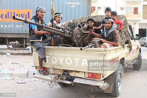 Yemeni fighters of the southern separatist movement loyal to exiled President Abedrabbo Mansour Hadi ride on the back of a vehicle in Aden's suburbs...