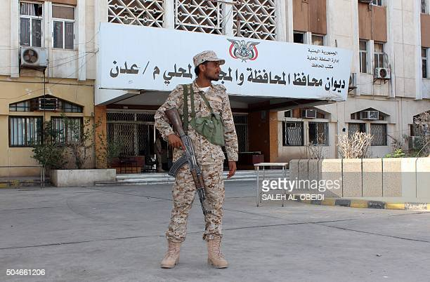 A Yemeni forces soldier stands guard outside the tribunal of the Yemeni governorate of Aden in the southern Yemeni city of Aden the government's...